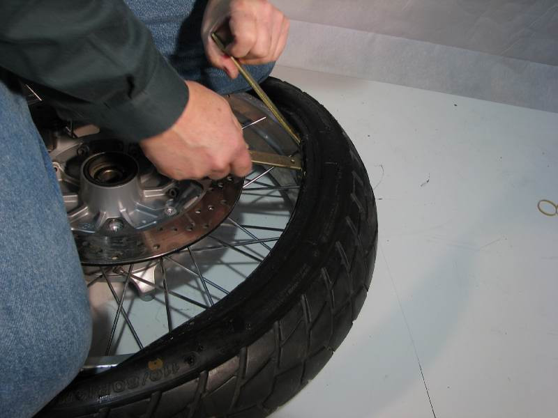 I stopped on the right, and moved over to the left side.  I leapfrogged the two left tire irons, working toward the right  Remember to keep the opposite bead in the CAVITY of the rim.