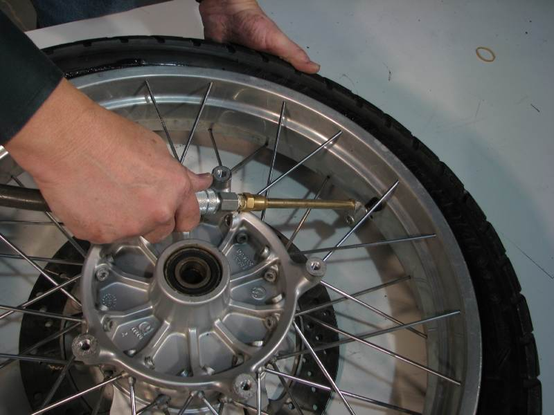 If you have a source of high pressure air attach your air chuck and give the tire a blast of air. (Some air chucks won't work unless there is a valve core inside the valve stem)