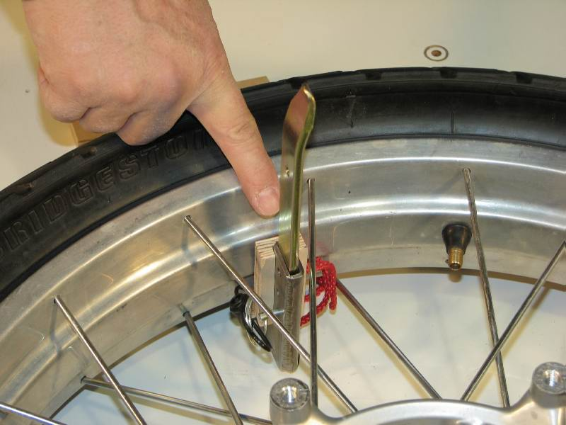 Note that the vertical tire iron is not touching a spoke.