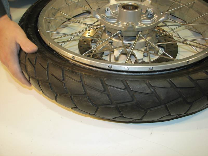 At last the bead is free from the rim, all the way around the tire.