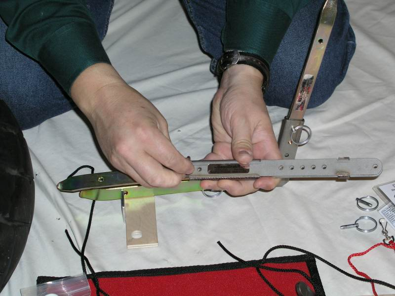 6.  Here a tire iron is being pinned into the Lever.