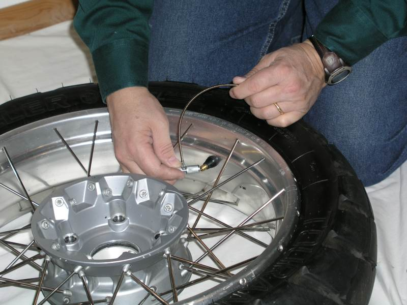3.  Use the Valve Stem Multi-Tool to deflate the tire and remove the valve stem.
