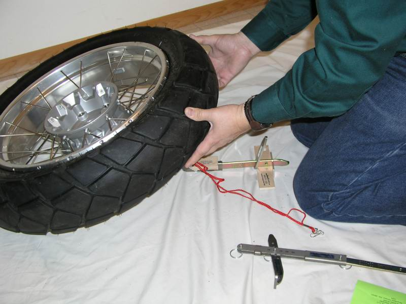 14.  Lowering the wheel into place.