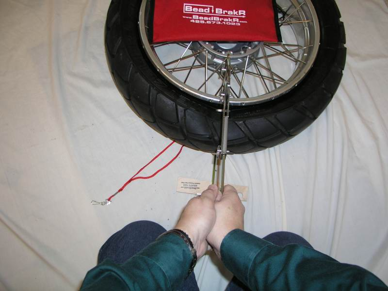 20.  Position yourself so you're facing the tire.  Kneel down so the sandfoot is between your knees.