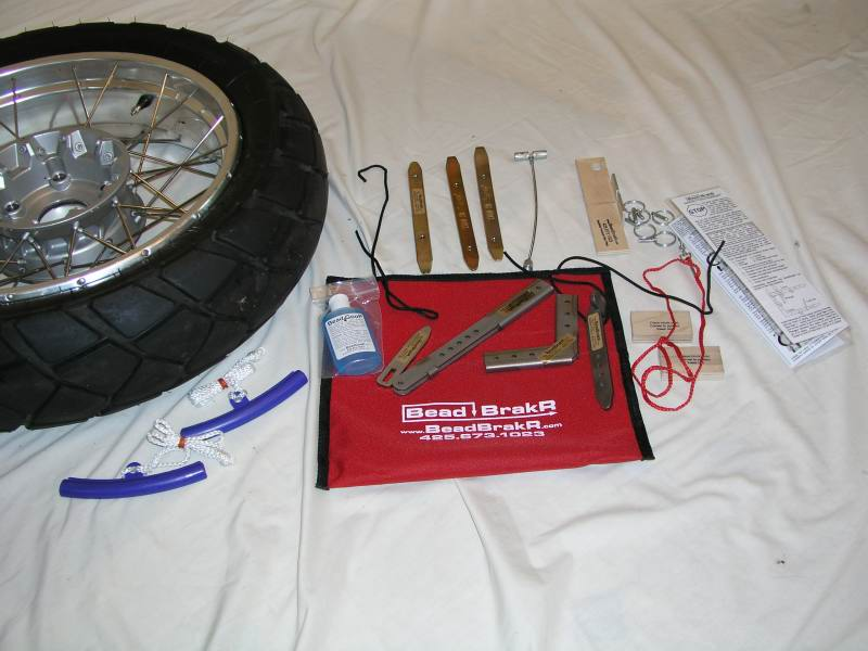 2.  Open the BeadBrakR pouch and lay out the parts.  Note that the red lanyard holds all the quick release pins; remove the pins from the lanyard before you begin.