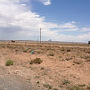 7/2 - US64, just outside Shiprock, NM. From the Four Corners Monument, I circled down into Arizona to Teec Nos Pos and turned east on US64 to officially begin my journey back towards home. Yea, I was fascinated by Ship Rock. <br /> <br /> I want to say that the speed limit between Teec and Shiprock was an absurd 60mph, but I can't be sure...I just remember it being ridiculously low given the wide open desert the road was going through. I came up on a suspicious looking white SUV traveling exactly at the speed limit. I was tempted to make a pass, but just made out a light bar hidden behind the very darkly tinted windows...trooper trying to goad a motorcycle into passing eh? I didn't play the game and ran behind him for miles until stopping to snap some pics. He pulled over to the side of the road way ahead of me and seemed to be waiting...I waited longer. There was no other traffic out there almost the entire time, lol. ;)