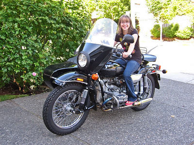 Natalie on Tom's Ural.