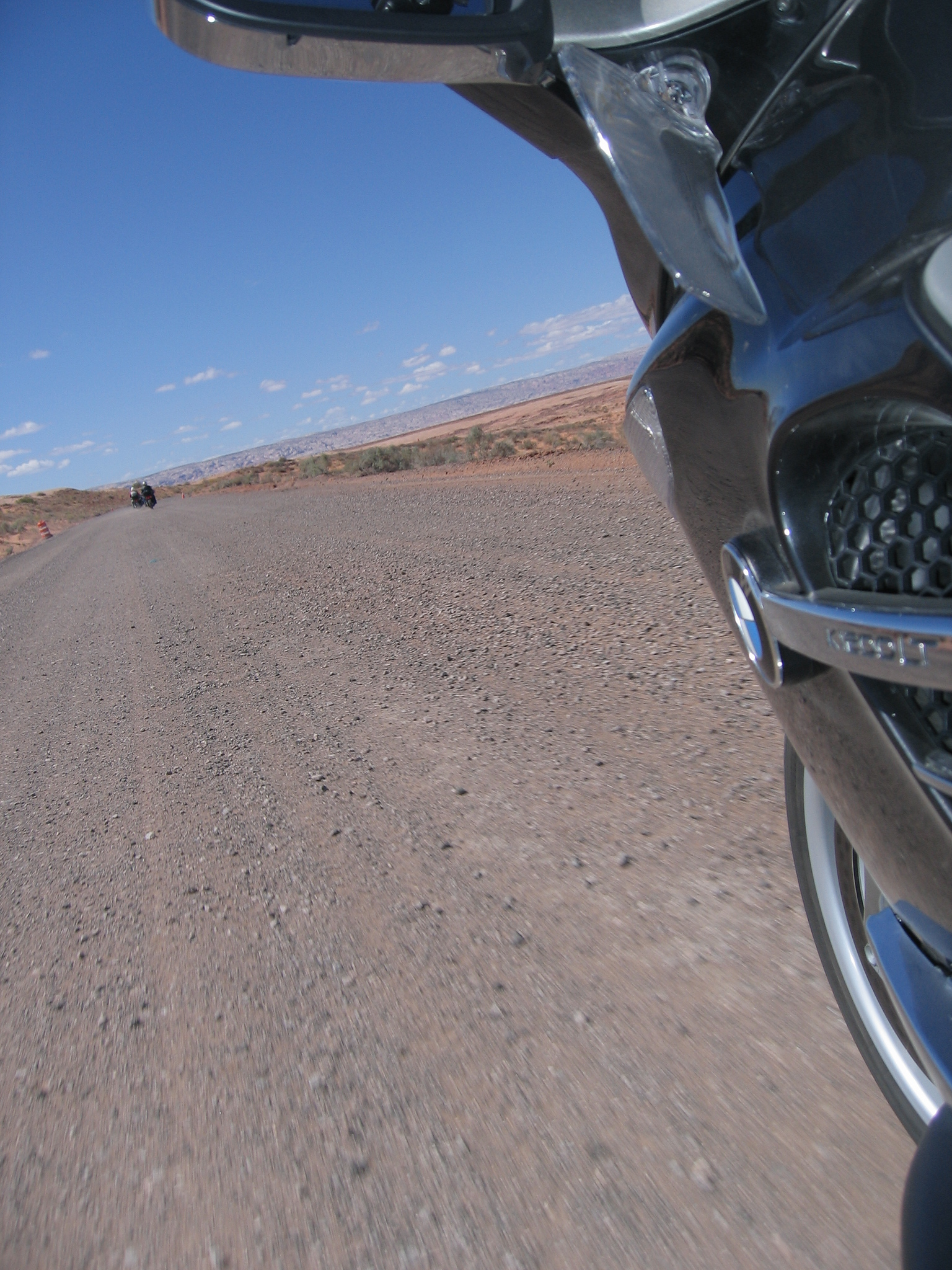 "Remember my ""more later"" on our chosen route to the lake?  Well, here was a surprise.  The road was torn up for about 6 miles.  Marbles on hard-pan.  Lovely.  We scooted along as best we could with time ticking away toward our ferry's departure hour!  Yikes...<br /> <br /> Remember ""The Fast Guy?""  He stopped to do as nature intended, and . . . . we almost didn't...."