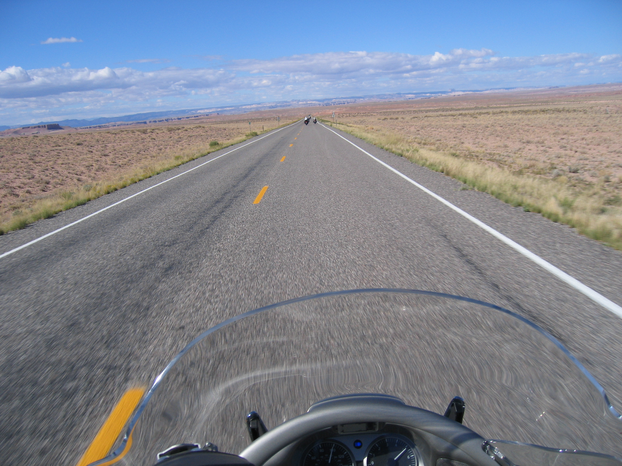 "Once off the boat and headed back to Torrey, we knew how open the roads were, and how little traffic there was, and aw shucks, hauling butt across the desert is such fun.<br /> <br /> If you look closely at Doug's tach and speedo, you'll see what I mean... he had ""slowed down"" to grab this photo!  Hey, Jamie, maybe Doug should have a nickname below his handle... something like ""The 100 MPH Photographer!"""