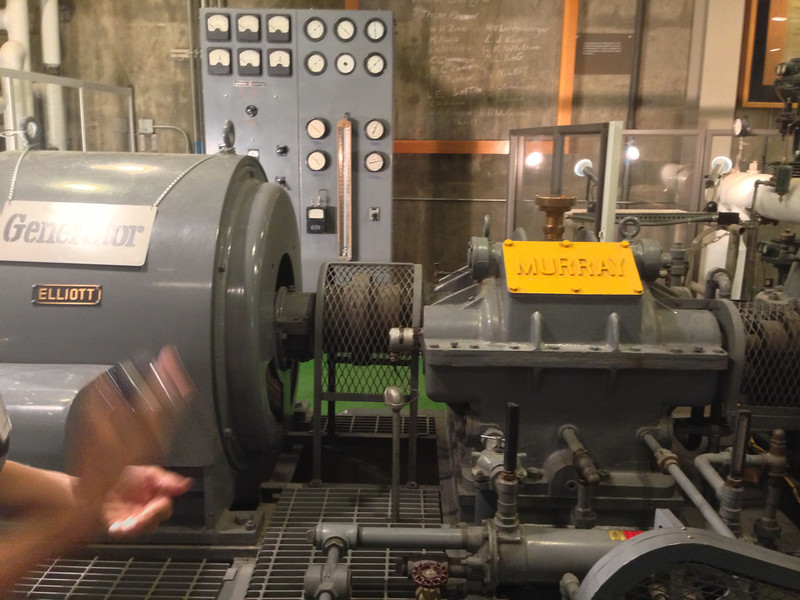 Generator driven by steam from a nuclear reactor.