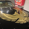 Hood of a Pontiac Firebird.