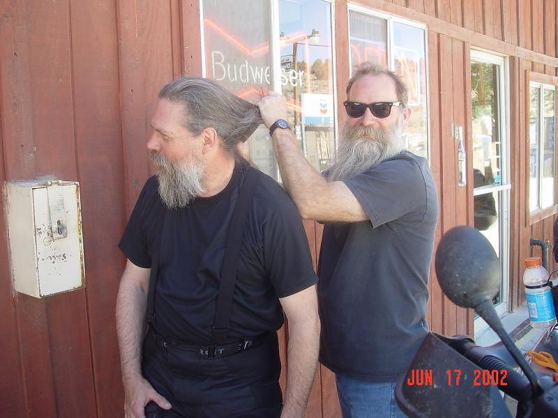 Tim gives Dave a hair cut