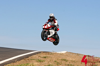 cory jumps his zx10 really high at thunderhill
