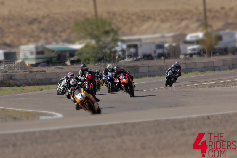 pack of riders in turn 1