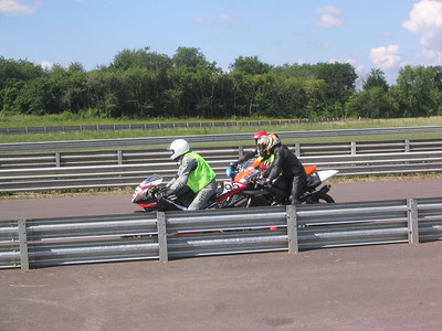 Trackday pics of myself and my friends on their bikes on the track. This is Joe, Mark, and I behind our control rider on our first trackday at Autobahn CC in Joliet