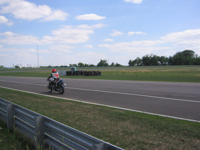 Trackday pics of myself and my friends on their bikes on the track - - Mark on his SV