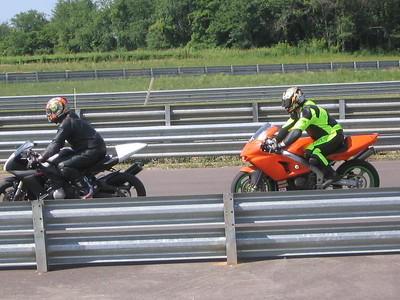 Joe and I on our first track day ato Autobahn, June 19th 2005 (Fathers Day). Not sure if it was this session or not, but Joe came off the bike in T11 on the south course and broke his collar bone and some other little things too.. At least it was during one of the last sessions.. In any case.. that's why he is wearing a sling in the Laguna Seca pictures taken about a couple weeks later... Greg Trackday pics of myself and my friends on their bikes on the track