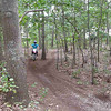 Max does a wheelie in the woods, then yields right-of-way to Sam.