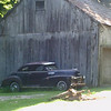 Cool old barn and car.