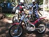 Getting ready for the 4 miles or so of trail riding to get to Funny Rocks from Rider Camp. Trail goes by Lost Lake and Manastash Lake. David on the yellow GasGas200 gives Daniel on the red GasGas280 some first-time trials bike rider tips.