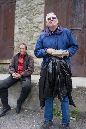 Dan, who didn't wear enough warm clothes, fitting himself with garbage bags.  Bonnie took pity on him, though, and gave him her rain pants.