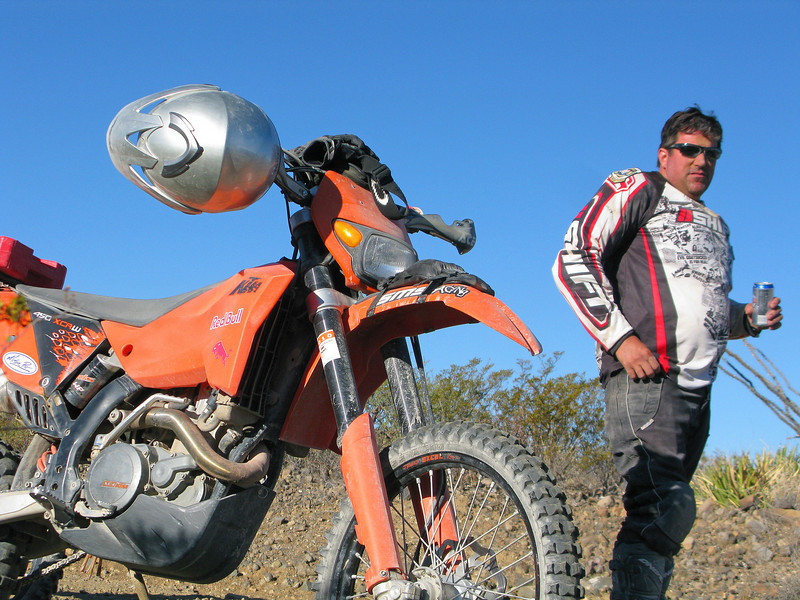 Mark sucking on a Silver Bullet and a vanity shot of Ken's KTM.