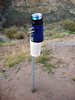Convenient roadside beverage holder. Might be a reflector, don't know.