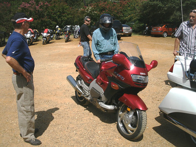 Jim looking at John with his '93 Yamaha GTS1000.  What a unique machine.