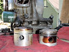 """X"" piston on left, stock 750 piston on right."