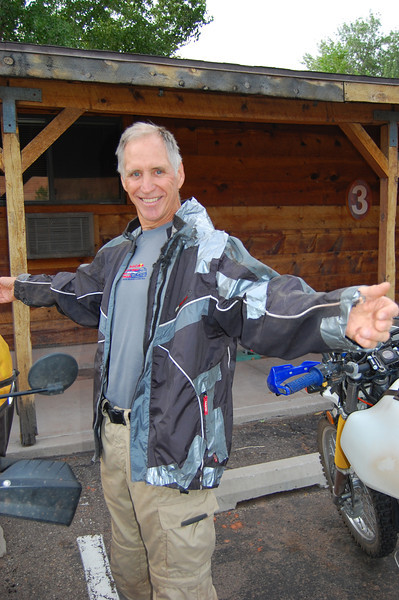 Carpenter Mike repaired his jacket with duct tape after it got got in his rear sprocket.