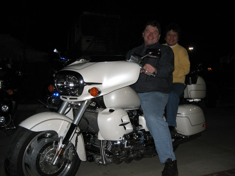 Norma and Dave Sheldon on thier pearl white IS.