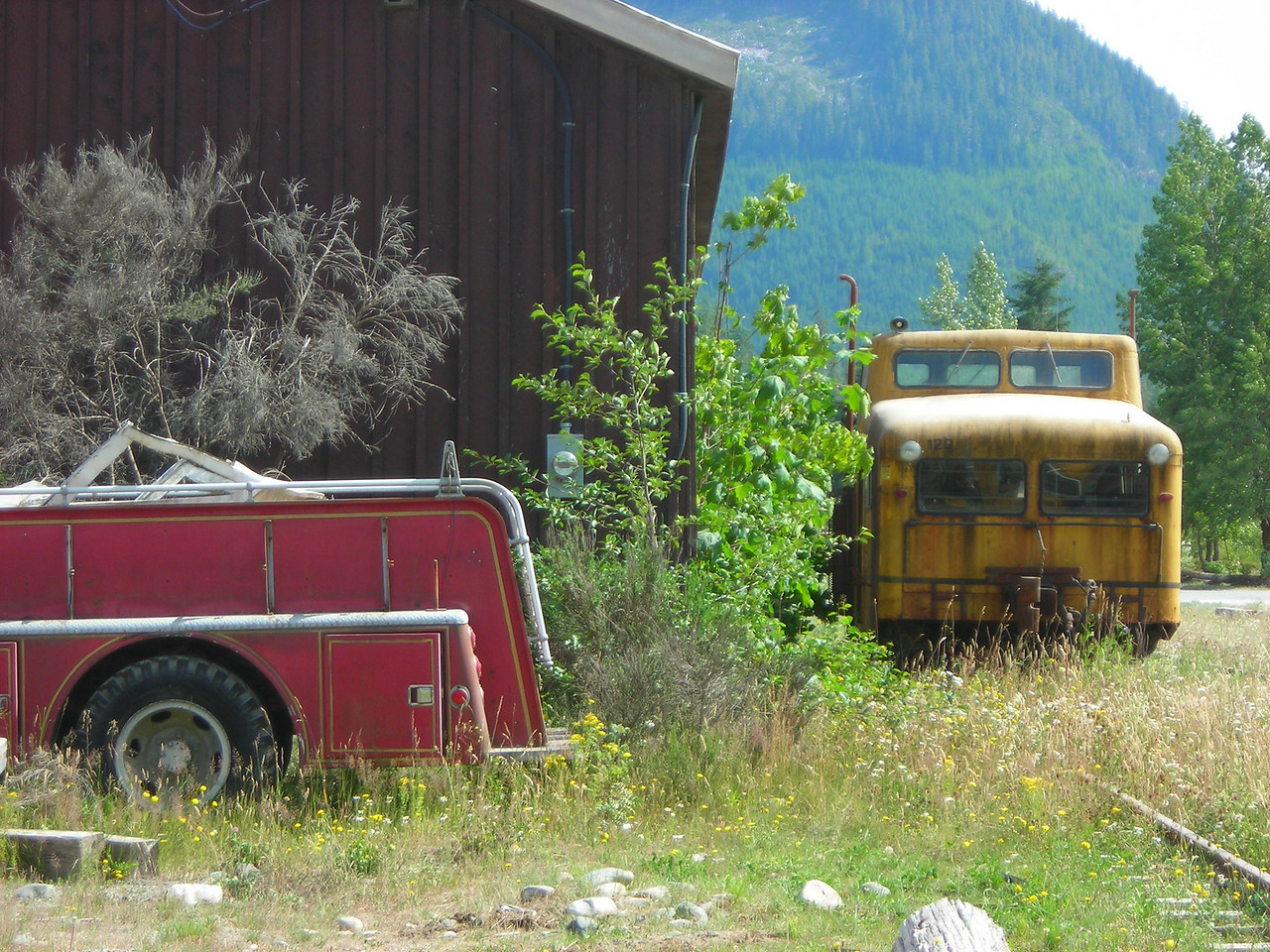 This crew bus is even hidden from view behind the shed