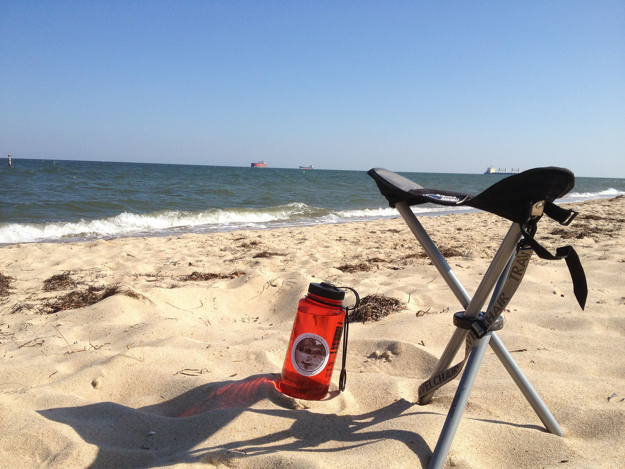 """Relaxing on the beach with my new """"Travel Chair"""""""