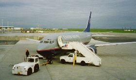 "Change planes at Detroit  This trip I flew to Richmond, VA to buy a Honda Pacific Coast. I wanted the owner to transfer the title and get me temp plates.  He seemed to think that a letterhead bill of sale would work.  He was a Campus Rent a cop at Martha Washington College.  The bike seemed OK so I was off.  Soon I realized that the windshild was too tall a quite opaque.  I ended up cutting it off in St. Louis.  A Missouri state cop fell in behind me north of St. Louis.  When I stopped to put on my rain gear he stopped and got out of the cruiser.  Looking at the VA plates he commented., ""Long way from home"".  I agree. He asks, ""Where you headed?"" I say, ""Montana""  He asks, ""Trouble?"" I say, ""No, just getting on the rain gear""  He never asks for my paperwork, follws me for about 4 miles, turns on the lights and I figure this is it.  Then he pulls a U and races off.    I named the bike the Rainmaker, it rained on me from VA to WY. And when I holed up in Canton, SD the TV said there were 7 tornados in Iowa that day. I rode from the SE corner to the NW corner. And my next trip to British Columbia was rained out.  I ended up riding to LA and sold it."