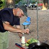 "The ""Chef Wayne"" chops garlic for the chili"