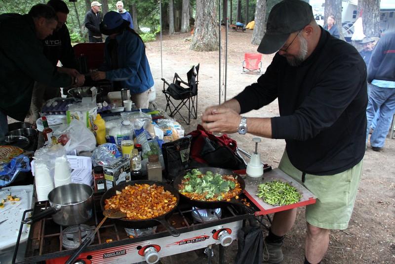 Wayne adds veggies to the other secret ingredients