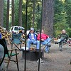 Scott Graham frames by the canopy poles relaxes by the fire
