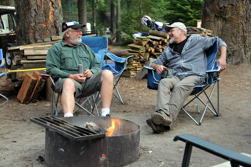 Mike and Ron enjoy a moment by the fire