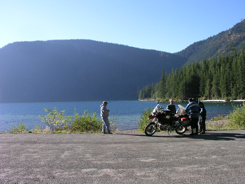 A camper comes to admire the adventuous motorbikers