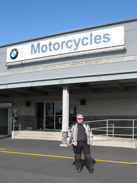 Bernie in front of our little local dealership.