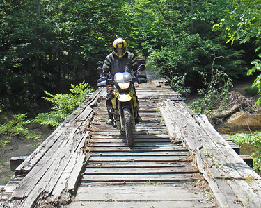 Fauster negotiating the rough and rotted surface of an old wooden bridge over Blue Creek.  Picture by RkyMtnMan.