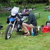 Stickman works on his sick bike.
