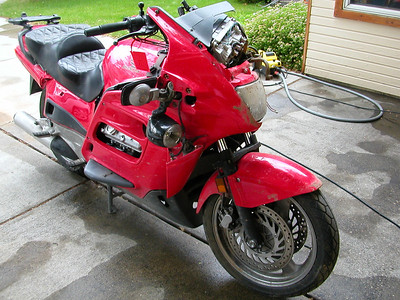 Once washed the bike looks as if it might be able to be a street fighter... Will... what do you want to do?   Inst cluster is trash but the individual gauges look OK..    all are for sale  All are for sale  Tires and wheels look OK  PIAA's are thrashed, one lens cracked and the cases are scrathed badly... I haven't tested 'em.   Brake reservoir and handle OK.  Clutch res is buggerd up and lever thrashed.   I pulled the 3 Ram mounts and your HID kit... the wire to the HID bulb plug pulled out but it looks repairable.  Givi rack is intact...  Right insp panel is OK...  Front fender is scratched up pretty good but paintable with min. sanding  Bottom fairing is trash as is nearly all tupperware.. tip over wing plastic is missing or broken.  Right pocket cover missing... left mirror cover missing...   Believe it or not the left side cover looks OK the right side is broken...  The entire rear section including rear fender and Givi rack looks OK