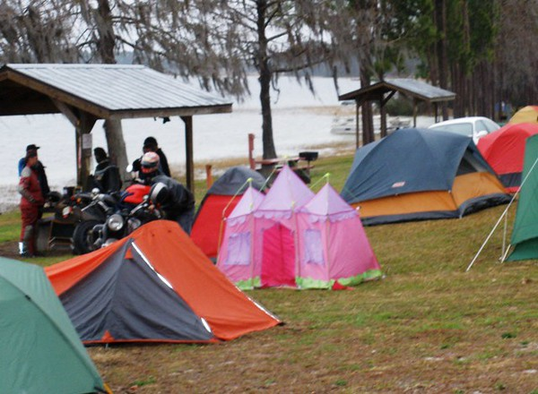 Suppose a big, tough biker wanted to camp, and did not have a tent.  He could always borrow one from his kids.
