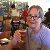 Kathy wrestles a  giant glass of Harpoon Camp Wannamango!