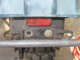 Going to reposition the license bracket and bob the inner fender. Start by removing the license plate bracket