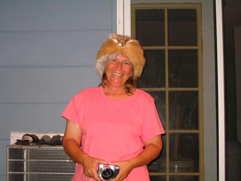 Linda wants Al's hat...
