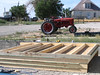 Chris' 1940 tractor. The walls for the equip shed was prefabed with two sections per side before lifting onto the stem wall.