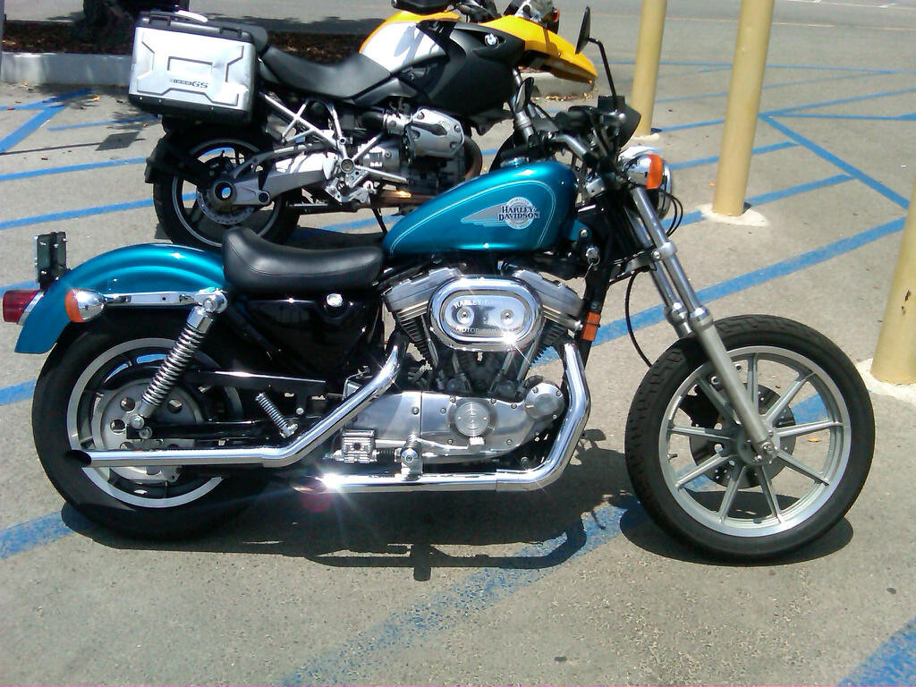 I wish I would have taken a picture of it the way I bought it. I stripped it down the minute I brought it home. It had a windshield, saddle bags, sissy bar, crash bar, and front fender which I removed right away.