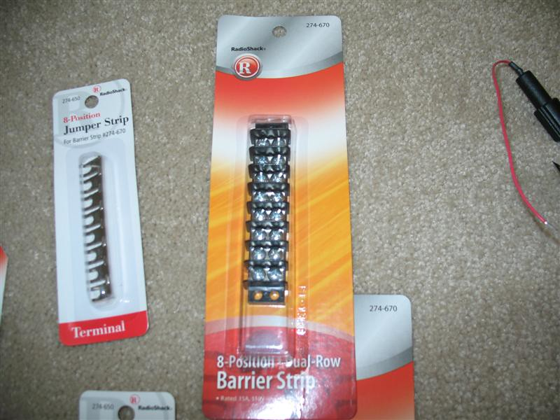 Radio Shack barrier strips, one for positive 12volt power and one for negative ground, are modified with their jumper strip so that a power lead from the battery/relay to the end terminal feeds power to all accessories connected to the other terminals.